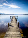 Jetty at the chiemsee in germany with blue sky Stock Photo