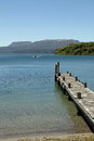 Jetty on lake tarawera with mt tarawera a dormant volcano in the background new zealand Stock Photography