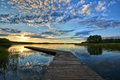 Jetty on lake view of wooden beautiful before sunset mazury poland Royalty Free Stock Image