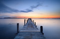Jetty at sunset in a fjord Royalty Free Stock Images