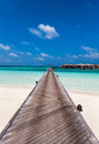Jetty to maldivian water villas wooden over turquoise waters Royalty Free Stock Photography