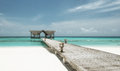 Jetty on a tropical beach maldivian Royalty Free Stock Image