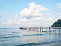 Jetty wooden bridge into blue sea and sky. Pier over water. Vacation And tourism concept. Tropical resort. Jetty on Koh Kood Islan Royalty Free Stock Photo