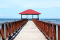 Jetty wooden with penthouse with red roof on blue sea sorong papua barat indonesia Stock Photo