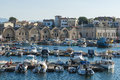 Jettys with moored boats arsenali chania in eastern harbour at the ancient roman shipyard crete greece Stock Image