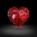 Jewel in the shape of heart on black background red Royalty Free Stock Photo