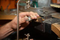 Jeweler hands at work Royalty Free Stock Photo