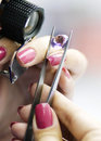 The jeweler jewelry tweezers selects best jewel Stock Photo