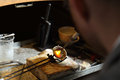 Jeweler melting precious metal with hydrogen burner Stock Photography