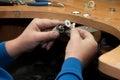 Jeweler polishes jewelry pendant