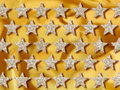 Jewelery gold stars background Stock Photography