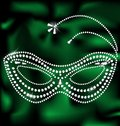 Jewelery mask on a green silk is a carnival Stock Images