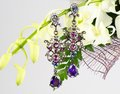 Jewellery on flowers luxury earrings in bouquet composition Royalty Free Stock Photo