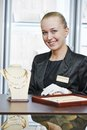 Jewellery shop sales assistant portrait of smiling female in jewelry Royalty Free Stock Photography