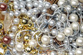Jewelry background these are many jewels necklaces pearls earrings as Stock Photo
