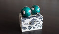 Jewelry box with two ball wooden and on it the yin yang sign Royalty Free Stock Photo