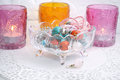 Jewelry earrings  in a glass vase with candles Royalty Free Stock Photo