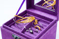 Jewelry gold and platinum in a purple box Royalty Free Stock Photos