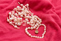 Jewelry made ​​of pearls on the pink Royalty Free Stock Photo