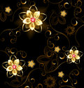 Jewelry pattern on a brown background of gilded flowers with bright rubies Royalty Free Stock Photography