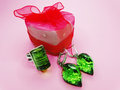 Jewelry ring and earrings with bright gem emerald crystals green near red box as present Stock Image