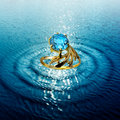 Jewelry ring in water waves golden topaz Royalty Free Stock Photography