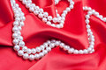 Jewels on white satin Royalty Free Stock Photo