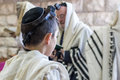 Jewish bar mitzvah , praying in a synagogue with tallit Royalty Free Stock Photo