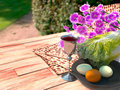 Jewish celebrate pesach passover background with eggs matzo and flowers on nature Royalty Free Stock Photo