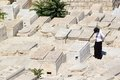 Jewish cemetery orthodox woman is praying in the ancient on the mount of olives jerusalem israel Royalty Free Stock Images