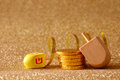 Jewish Hanukkah with dreidel (spinning top) and chocolate coins Royalty Free Stock Photo