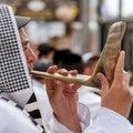 Jewish hasid blows Shofar. Rosh Hashanah, Jewish New Year.
