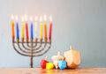 Jewish holiday Hanukkah with menorah wooden dreidels (spinning top). Royalty Free Stock Photo