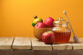 Jewish holiday Rosh Hashana (New Year) celebration with honey jar and apples Royalty Free Stock Photo