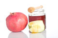 Jewish new year tradition of dipping an apple slice in honey symbolic for a sweet Royalty Free Stock Photos