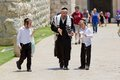 Jewish orthodox man and children with traditional dress hat hairstyle are walking in the jerusalem old town near the jaffa Royalty Free Stock Photo