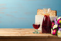 Jewish Passover holiday Pesah celebration concept with matzoh and wine