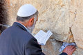 Jewish reading and praying at the western wall Stock Photo