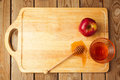 Jewish Rosh Hashana (New Year) holiday background with apples and honey on wooden board. View from above Royalty Free Stock Photo