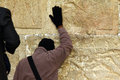 Jewish worshiper prays at the wailing wall jerusalem israel december an important religious site winter on december in Stock Photography