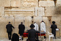 Jews worship at the stones of  the Western Wall Royalty Free Stock Photo