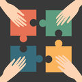 Jigsaw hands and puzzle unity conceptual Royalty Free Stock Image