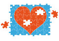 Jigsaw puzzle heart, vector Royalty Free Stock Images