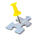 Jigsaw puzzle piece pinned with yellow pin in shape of a man on white background Stock Image