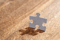Jigsaw Puzzle Piece in Shape of a Man Royalty Free Stock Photo