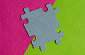 Jigsaw Puzzle pieces on border between pink and green background Royalty Free Stock Photo