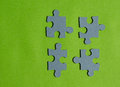 Jigsaw puzzle pieces on bright green background, horizontal view Royalty Free Stock Photo