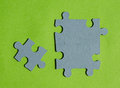 Jigsaw puzzle pieces on bright green background Royalty Free Stock Photo