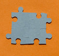 Jigsaw puzzle pieces on bright orange background Royalty Free Stock Photo
