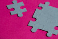 Jigsaw puzzle pieces on bright pink background, horizontal Royalty Free Stock Photo